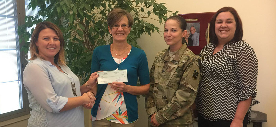 Check donation to military group