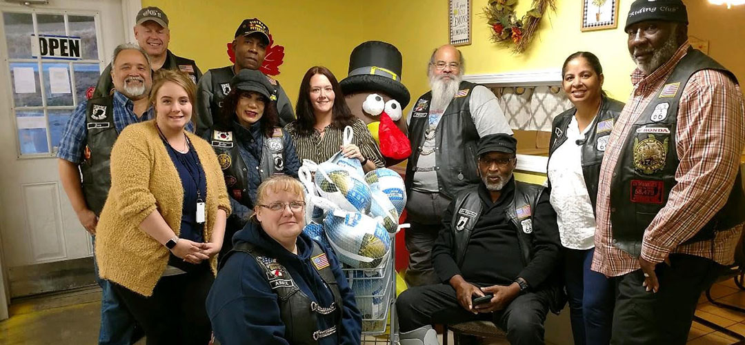 Motorcycle group with donated turkeys
