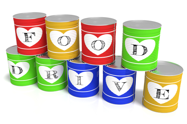 Nine stacked tin cans in different colors each with a letter of the words food drive